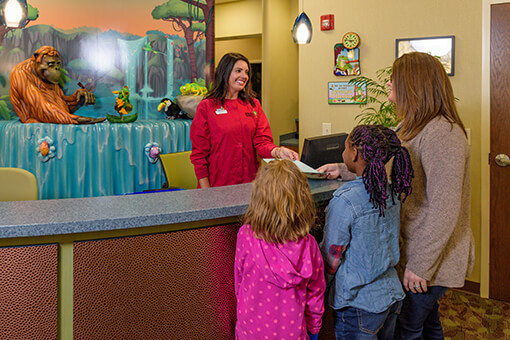Greeting patients at front desk in High Point Pediatric Dentistry